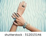 female hands with jewelry on... | Shutterstock . vector #512015146