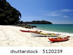Three kayaks in Abel Tasman National Park, New Zealand - stock photo