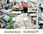 sewing industry with laborers | Shutterstock . vector #512046379