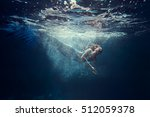 underwater shot with free diver ... | Shutterstock . vector #512059378