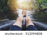 man floating down a canal in a... | Shutterstock . vector #512094808