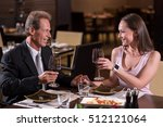 delighted couple drinking wine... | Shutterstock . vector #512121064