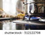 vegetable steamer on a gas hob.  | Shutterstock . vector #512122708