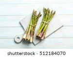 Fresh Green Asparagus On A Blue ...