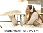 girl with eyes closed listening ... | Shutterstock . vector #512197174