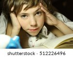 teenager boy reading book with... | Shutterstock . vector #512226496