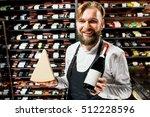 portrait of a sommelier in... | Shutterstock . vector #512228596
