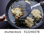 turning over frying latkes with ... | Shutterstock . vector #512240278