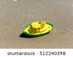 Toy Boat In The Wet Sand Of Th...
