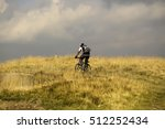 young man cyclist with backpack ... | Shutterstock . vector #512252434