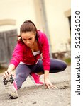 young fitness woman stretching... | Shutterstock . vector #512261050
