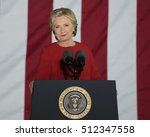 Small photo of PHILADELPHIA, PA - NOVEMBER 7, 2016: Hillary Clinton smiling. The Democratic Presidential nominee gestures smug smile at a campaign rally on the eve of the US election.