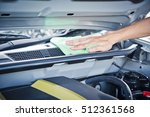 wipe cleaning the car engine... | Shutterstock . vector #512361568