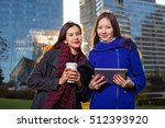 two asian woman holding coffee... | Shutterstock . vector #512393920