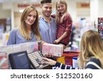 family packing shopping at... | Shutterstock . vector #512520160
