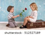 Little Boy With A Rose For His...