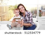 mother with son on kitchen | Shutterstock . vector #512534779