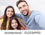 happy family taking selfie at... | Shutterstock . vector #512534950