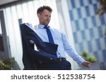 thoughtful businessman holding... | Shutterstock . vector #512538754