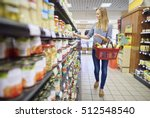 woman buying products in food... | Shutterstock . vector #512548540