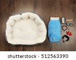 Stock photo pet accessories on wooden background 512563390