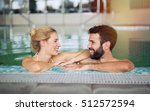 beautiful couple enjoying spa... | Shutterstock . vector #512572594
