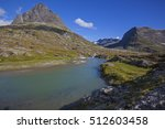 small mountain lake over peaks... | Shutterstock . vector #512603458
