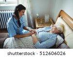 nurse interacting with senior... | Shutterstock . vector #512606026