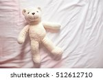 Smiley Bear Doll Laying On...