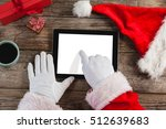 Hand Of Santa Claus Using...