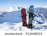 Two snowboard standing in the snow against the backdrop of the beautiful snow-capped mountains - stock photo