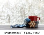 red mug with a warm scarf and... | Shutterstock . vector #512674450