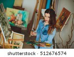 woman artist painting a picture ... | Shutterstock . vector #512676574