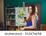 woman artist painting a picture ...   Shutterstock . vector #512676658