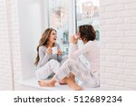 two pretty girls in pajamas... | Shutterstock . vector #512689234
