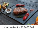 grilled beef steak cooked on... | Shutterstock . vector #512689564