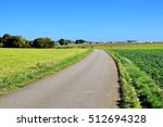 green field on blue sky  | Shutterstock . vector #512694328