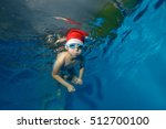 Child In Hat Santa Claus Swims...