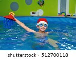 child in hat santa claus swims... | Shutterstock . vector #512700118