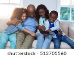 family using mobile phone at... | Shutterstock . vector #512705560