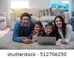 portrait of family using laptop ... | Shutterstock . vector #512706250