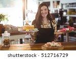 portrait of waitress standing... | Shutterstock . vector #512716729