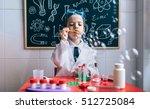 kid doing soap bubbles against... | Shutterstock . vector #512725084
