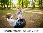 Boy And Girl On A Tire Swing....