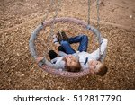 boy and girl on a swing.... | Shutterstock . vector #512817790