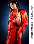 Sexy japanese woman on red kimono. - stock photo