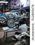 working in garage | Shutterstock . vector #512845678