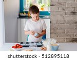 Child Placing Cupcake Forms In...