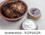 latkes in a ceramic rustic... | Shutterstock . vector #512916124