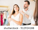 handsome young man buying some... | Shutterstock . vector #512924188